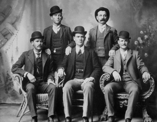 "The Wild Bunch in Fort Worth, November 1900. Top row (left to right): Will Carver and Harvey ""Kid Curry"" Logan. Bottom row (left to right): Harry ""the Sundance Kid"" Longbaugh, Ben ""the Tall Texan"" Kilpatrick, and Butch Cassidy."