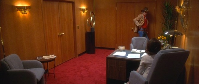 Webb hooks his thumbs through the smaller belt while cooling his heels in Rothstein's outer office.