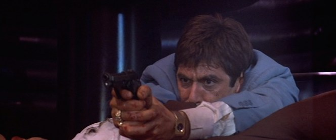 Tony uses his Beretta to great effect after he finds himself cornered by assassins at The Babylon club.