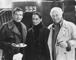During the filming of The Spy Who Loved Me in December 1976, Roger Moore takes a break with Curd Jürgens and Curd's future wife Margie Schmitz to celebrate Curd's 61st birthday on set.