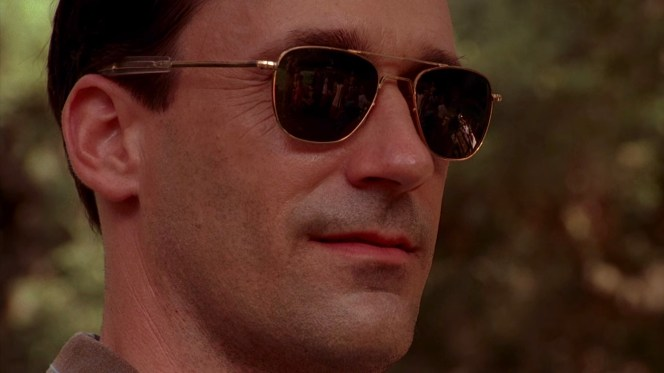 Don Draper's Saturday: sunglasses, stubble, and satisfaction.