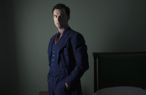 Production photo of Aidan Turner as Philip Lombard. Note the generous trouser fit thanks to the pleats and the full cut as well as the elevated lowest button on the waistcoat situated so that the vest can be worn fully fastened.