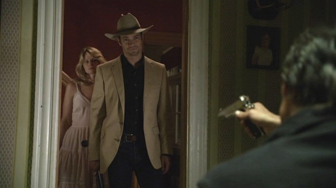 Raylan defines cool, calm, and collected as he stands before a .45-waving Boyd Crowder.
