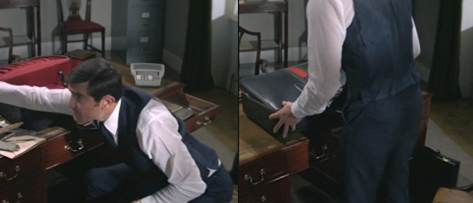 Of course, it's a Gucci case that Bond uses when packing up his office belongings.
