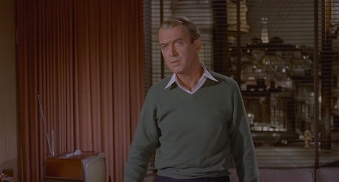 Scotty exudes earthy comfort in his soft moss-toned sweater.