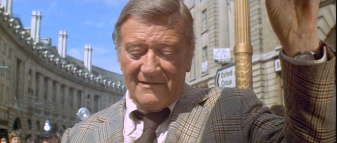 Note the grenadine weave of Brannigan's brown silk tie.