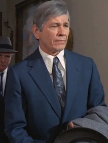 Charles Bronson as Joe Valachi attending the Apalachin meeting in The Valachi Papers (1972)