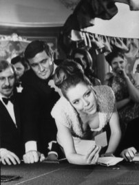 George Lazenby and Diana Rigg on the casino set.