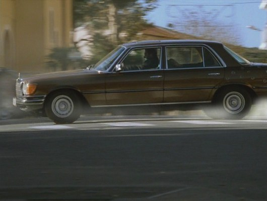 Vincent's Mercedes-Benz 450SEL 6.9 proves its performance virtues during a chase along the French coastline.