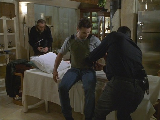 Vincent helps Sam out of his bulletproof vest after an incident at the Arles Amphitheatre.
