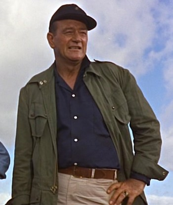 "John Wayne as Michael ""Guns"" Donovan in Donovan's Reef (1963)"