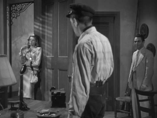 Bogie and Bacall make their first cinematic contact and the screen sizzles.