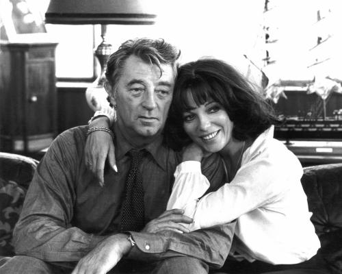Robert Mitchum and Joan Collins between takes. Spot the Rolex on Mitchum's left wrist.