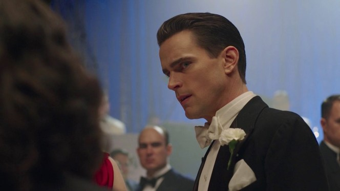 Why the discomfort, Monroe? Perhaps it's that prom-style boutonnière... or perhaps it's the widow publicly blaming you for her troubled husband's suicide.
