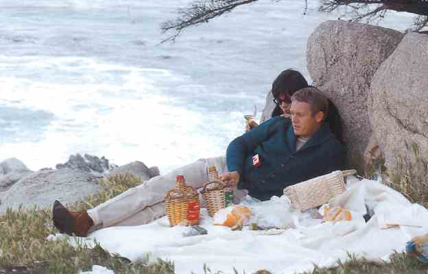 Steve McQueen and his wife Neile Adams in respite. (Photograph by William Claxton, 1964)