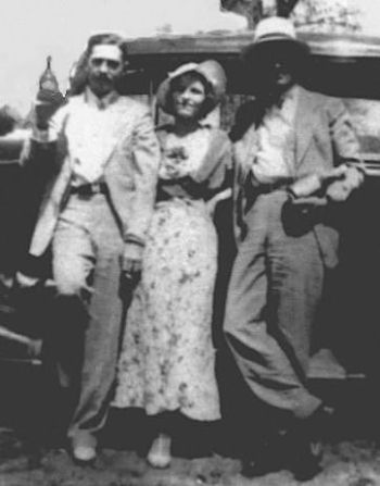 Clyde Barrow, Bonnie Parker, and Henry Methvin, likely taken by associate Joe Palmer in late March 1934, just before the Grapevine killings. Note Clyde's natty summer suit and mustache, clear indications that he is hoping to emulate the style of felonious idols like John Dillinger.