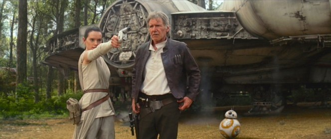 Rey practices aiming the blaster offered to her by Han as BB-8 lurks in the background.