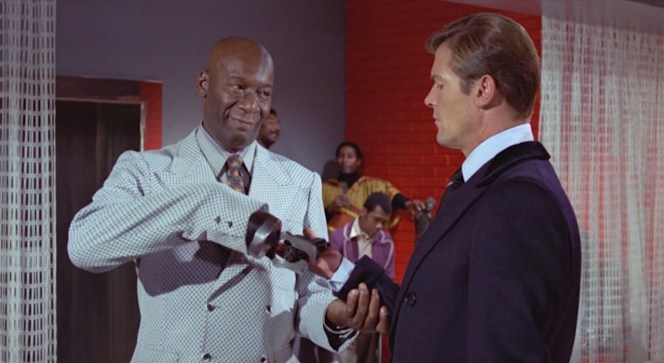 Tee-Hee hands Bond's disfigured PPK back to him, which still seems like a bad idea for a villain's henchman to do. Still, the risk pays off for Tee-Hee as Bond merely discards the still-loaded pistol in the trashcan.
