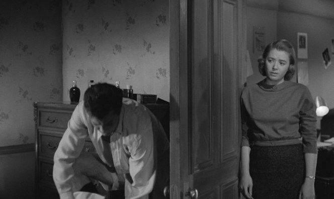 Sidney's long-suffering assistant, Sally (Jeff Donnell), stands by while he changes his pants.