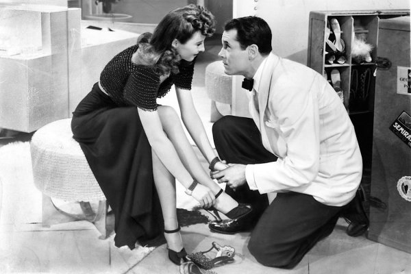 Production photo of Barbara Stanwyck and Henry Fonda filming The Lady Eve.