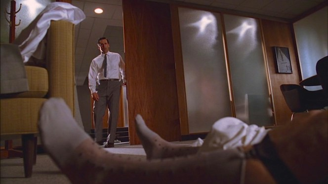 An unusual sight greets Don Draper upon his return to Roger's office.