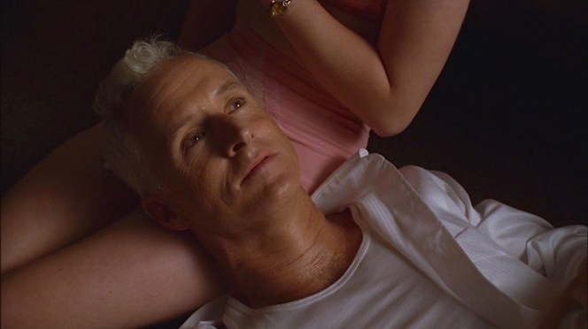 Roger Sterling finds a friendly, comfortable place to rest his head.