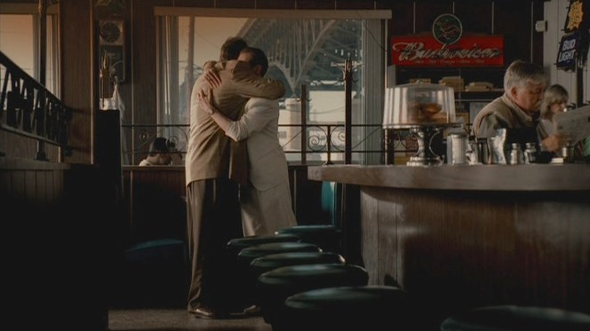 """The reacquainted cousins embrace after sharing breakfast following an all-night party in """"Rat Pack"""" (Episode 5.02)."""