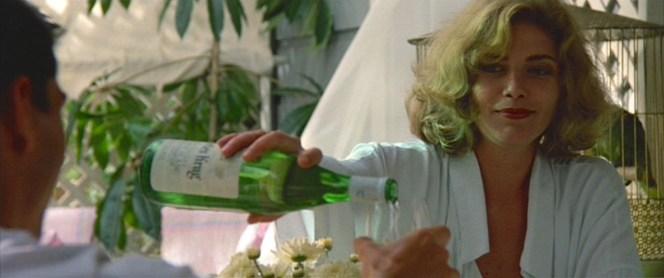 Charlie tops off Maverick's glass.