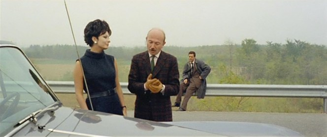 In his plaid sport jacket, Giorgio Ferrario (Armando Trovajoli) looks like he could be just as willing to sell Anna a car as much as he's willing to give her a ride in his own. His sense of style adds a new level that clearly interrupts the dynamic of sophisticated Anna and the subdued Renzo.