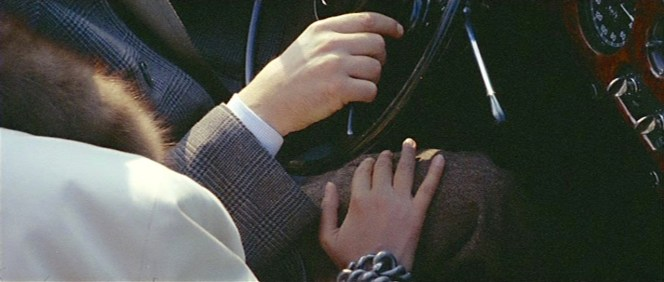 Note the details of Renzo's glen plaid coat, mini-checked white shirt, and brown tweed trousers. Note also Anna's roving hand, which considerably shortens the life of her dear Rolls-Royce.