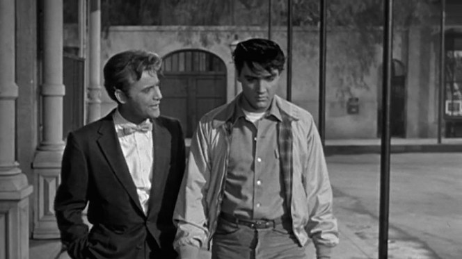 Danny receives a summons to see Maxie from Shark (Vic Morrow), one of his newly hired street hoods who adopts the somewhat less-than-intimidating livery of a suit and a bow tie.