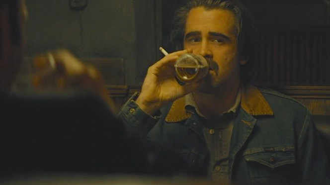 Velcoro enjoys his usual vices of a cigarette and a beer.