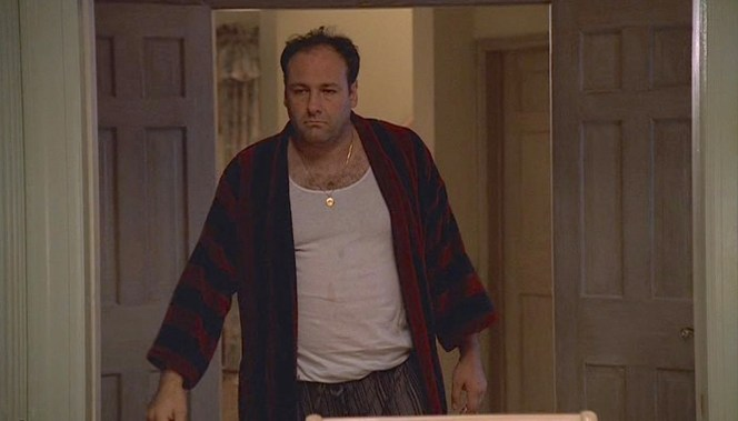 """Wearing a robe more for casual leisure than luxury, a depressed Tony Soprano joins his family for dinner in """"Isabella"""" (Episode 1.12), the penultimate episode of the first season of The Sopranos."""