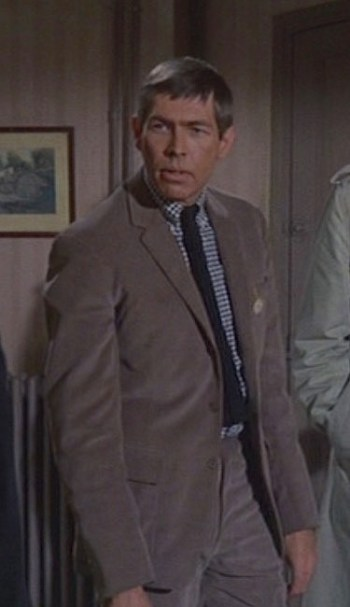 James Coburn as Tex Panthollow in Charade (1963)