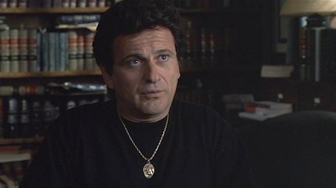 Any idea what's on Vinny's pendant?