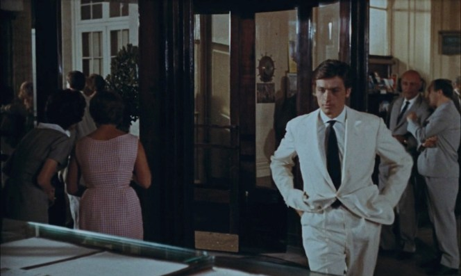 Ripley's white suit shines as he strolls through the much more conservatively dressed crowd outside the Excelsior on a warm summer night in Rome.