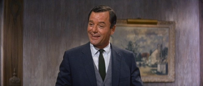 Roger gets earthy with his dark green knit tie.