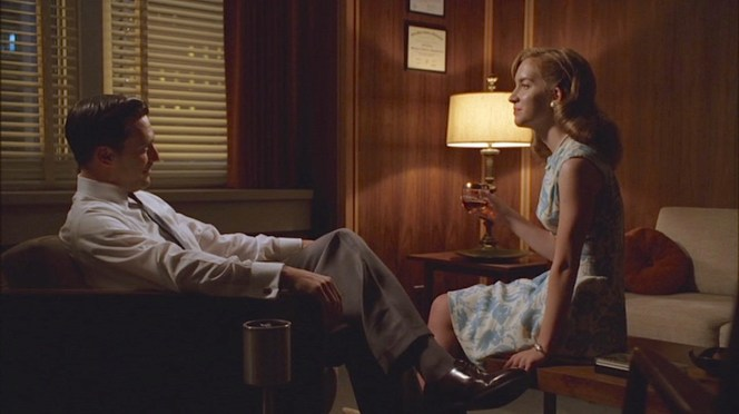 Late night entertaining in Don Draper's wood-paneled office.