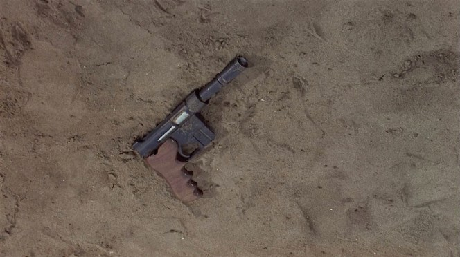 Matt's pistol falls to the ground during a fight at Dr. Wall's base.