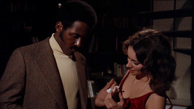 Back at his apartment, Shaft gets some TLC from Linda (Margaret Warncke), his date for the evening.