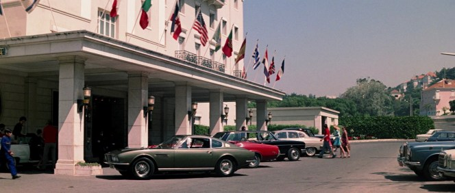 Bond gets a prime parking spot for his Aston Martin next to Tracy's Mercury Cougar in front of the Hotel Palácio Estoril.