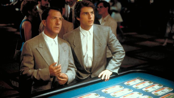 Production photo of Dustin Hoffman and Tom Cruise in their new gray suits and at the tables in Rain Man.