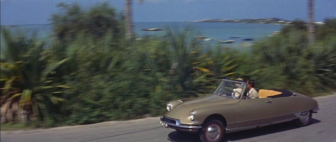 "As noted in the film's ""Goofs"" entry on IMDB, not only should Philip not be driving on the right side of the road as Bermuda enforces left-side driving, he shouldn't be driving himself as Bermuda doesn't offer car rental and only residents are allowed to own cars. It makes for a picturesque scene, though!"