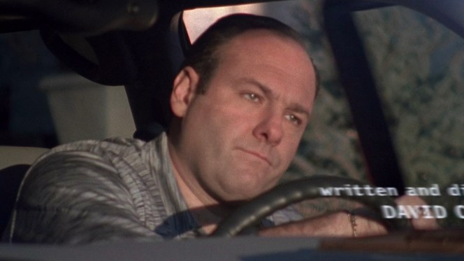 """Tony steps out of his Suburban in the closing shot of The Sopranos' opening credits, here sourced from the final episode """"Made in America"""" (Episode 6.21), written and directed by series creator David Chase."""