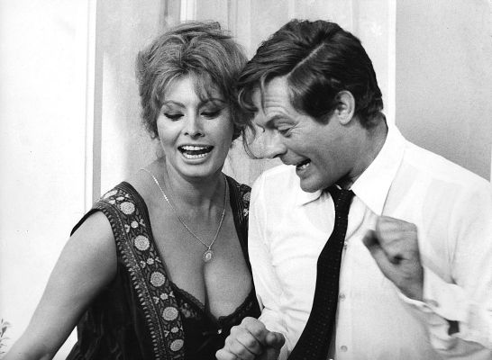 Production photo of Sophia Loren and Marcello Mastroianni dancing on the set of Yesterday, Today, and Tomorrow.