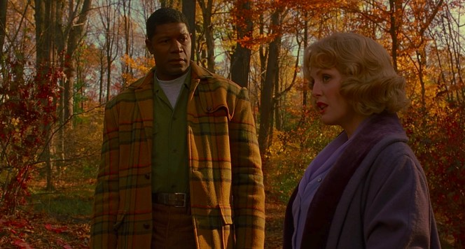 """Raymond's colorful jacket blends against the autumnal leaves, communicating both his earthiness and that the two are sharing their last moments of relative peace while his association with Cathy is still """"unseen"""" to much of her social world."""