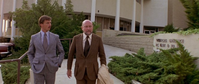 Smith's Grove Sanitarium administrator Dr. Terence Wynn (Robert Phalen) accompanies a gruff Dr. Loomis out to his rented BMW. The briefly seen character of Dr. Wynn would get a much deeper—and darker—role in future sequels in the franchise as well as Rob Zombie's 2007 reboot.
