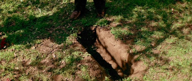 Dr. Loomis makes the unwelcome discovery that Michael Myers has already dug up his sister Judith's tombstone.