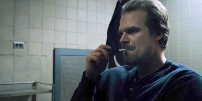 A defiant smoke during his interrogation.