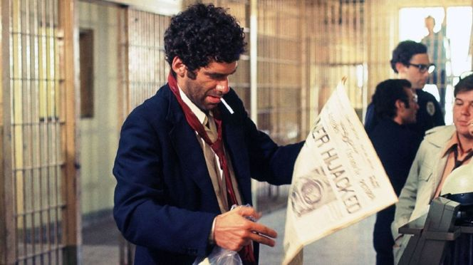 "Production photo of Elliott Gould as ""Rip Van Marlowe"", awakening to the changing times."